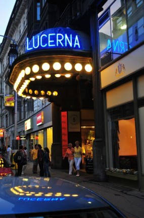 Lucerna music bar, one of the oldest bars, has 80's music playing all night long and maybe you can catch a live gig.