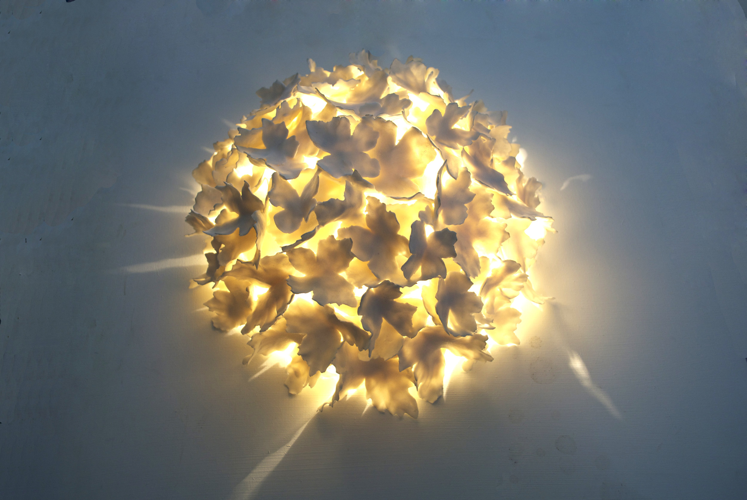 This domed version was made to sit on a wall, fully surrounding the light source and creating bursts of light that shot out of the sides. This version can also be used on ceilings. Approximately 400mm diameter. £800 plus vat.