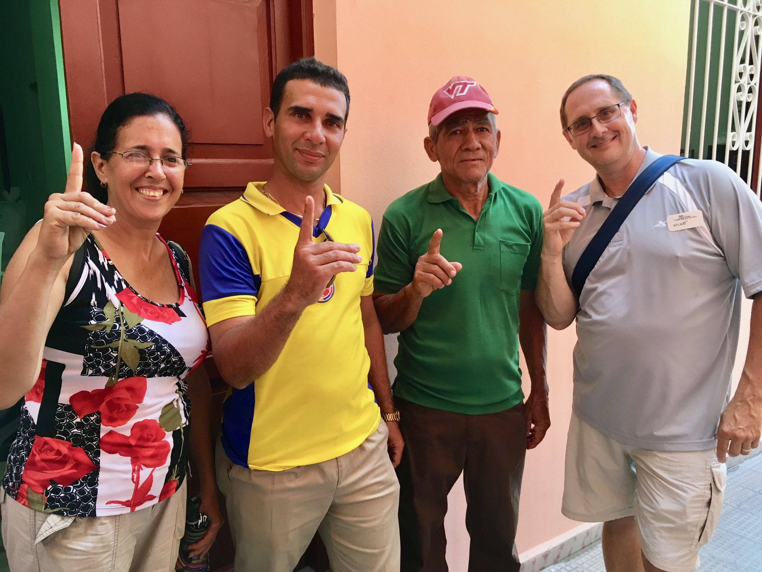 "A chance meeting at Guantánamo Baptist Church. The deaf in Cuba I met are proud to be identified as Christians.  They are showing the Cuban sign for God- which is the same as the letter ""d"" in American Sign Language."