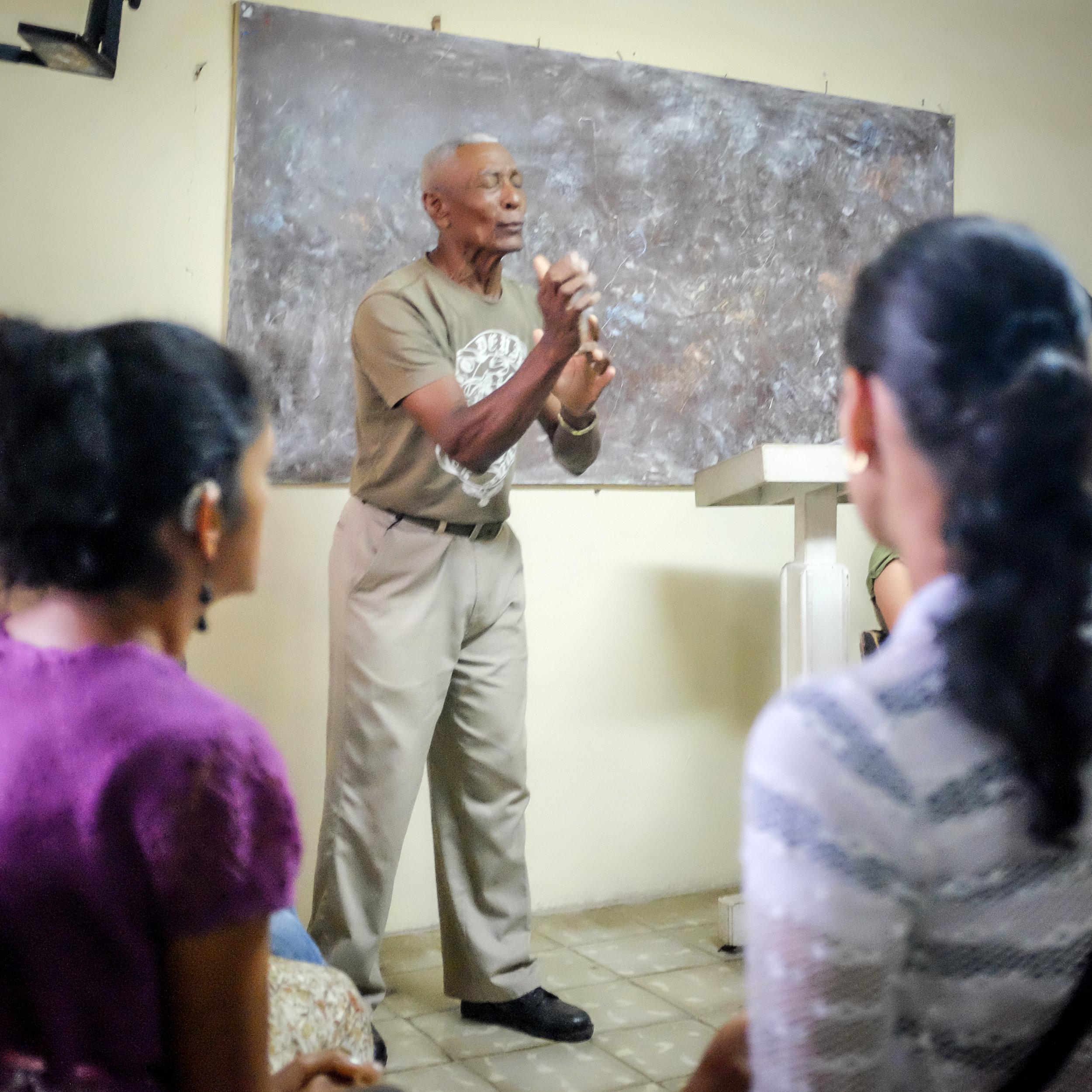 Leading the Cuban Deaf in prayer. Baracoa