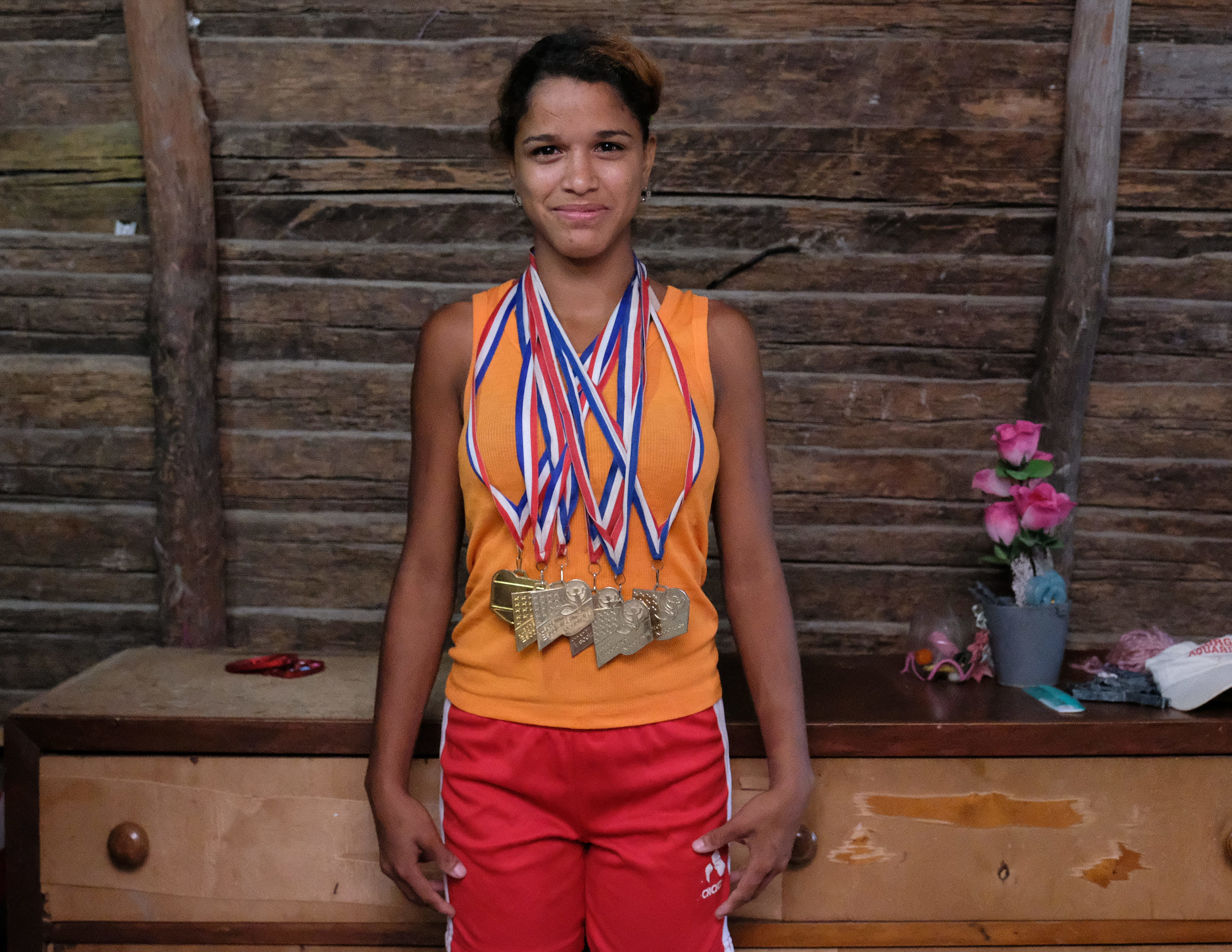 Sporting her 6 Gold Medals in track events