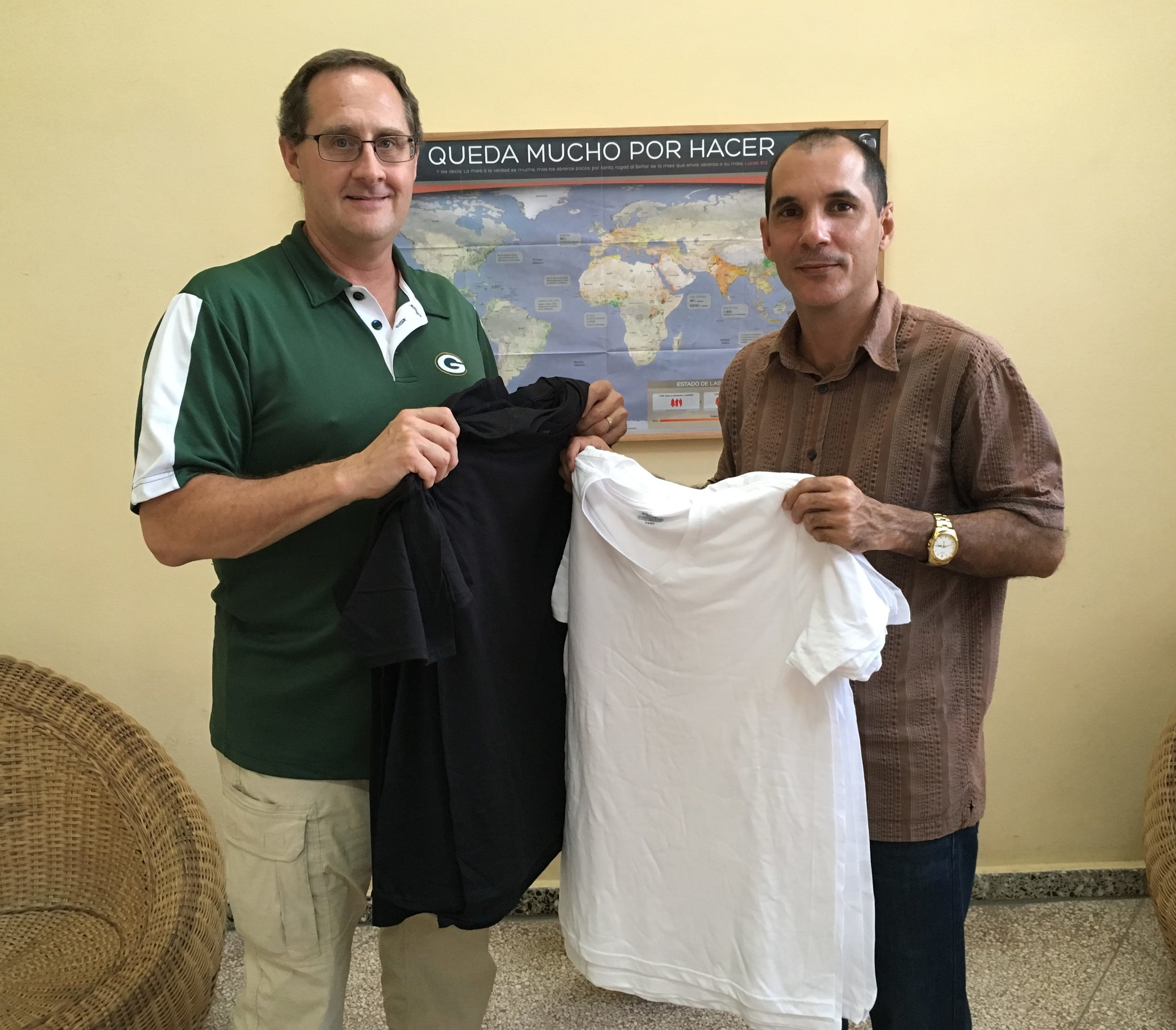 T-Shirts being received by Pastor Joel of the 1st Baptist Church, Guantánamo, Cuba