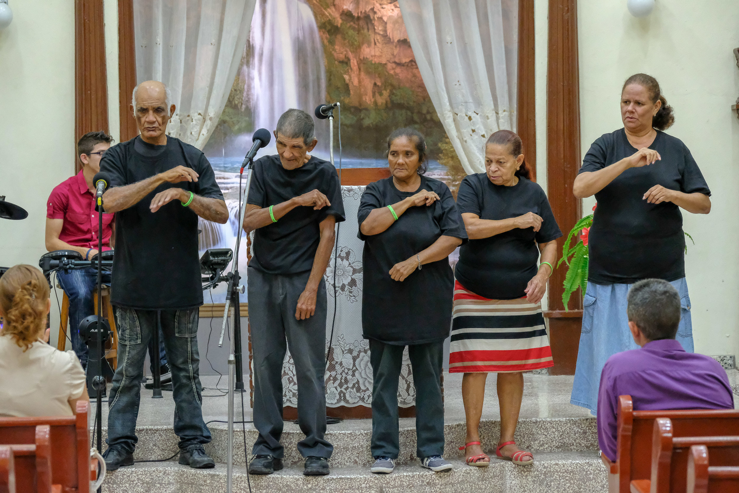 Deaf Adults performing a signed song they learned in a recent deaf ministry event.