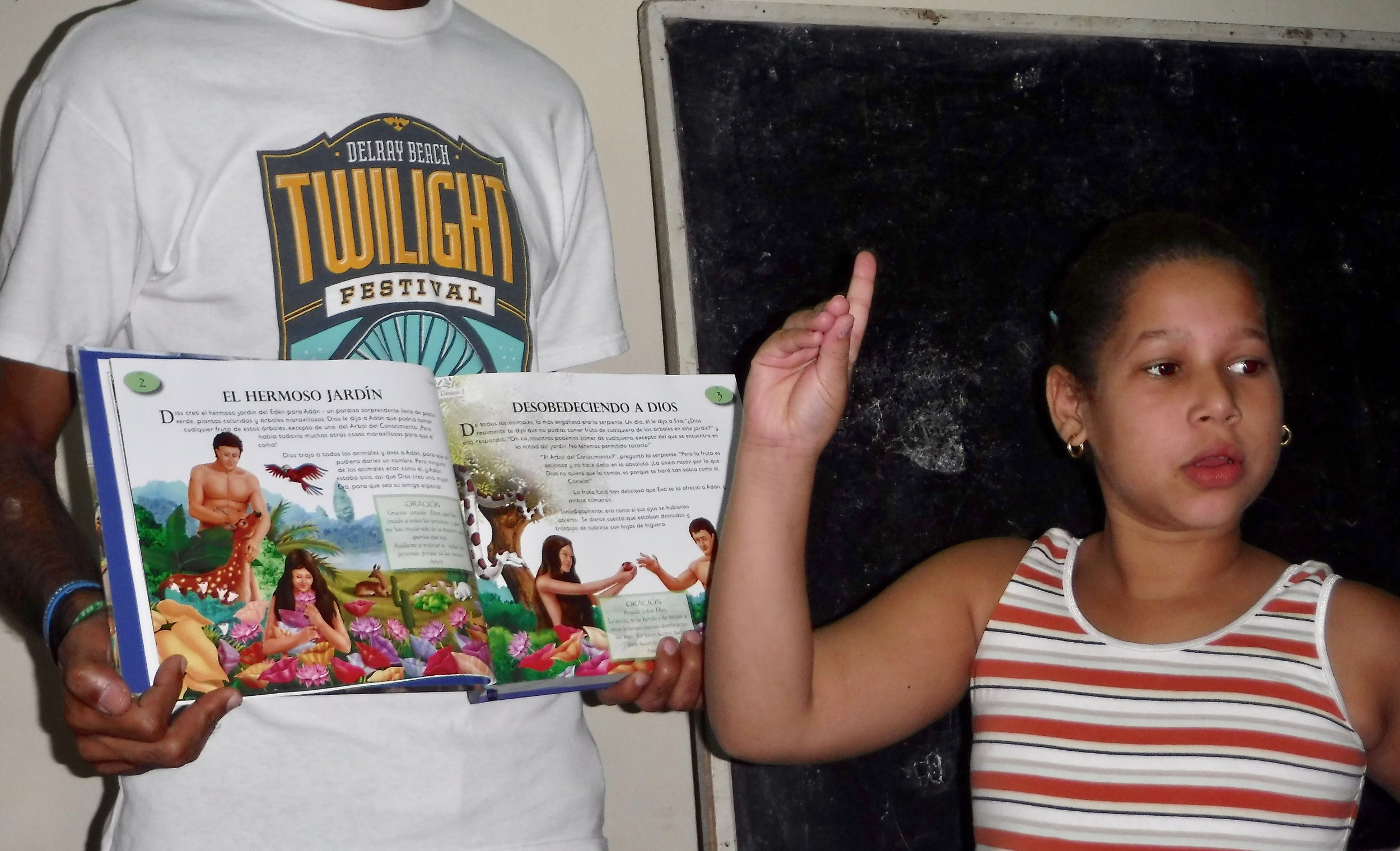 Cynthia reads and signs the stories from their new interactive Spanish Bible Story book to her class