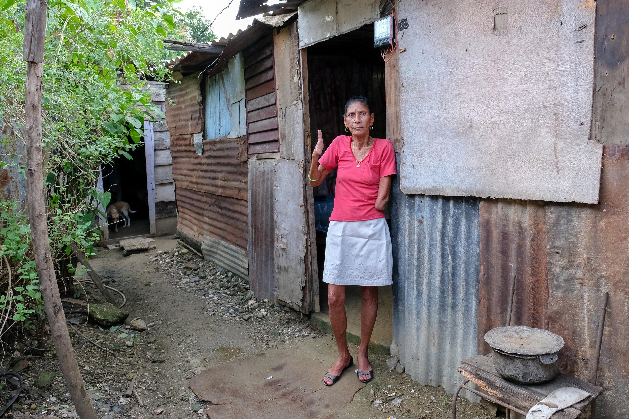 Damaris at her front door