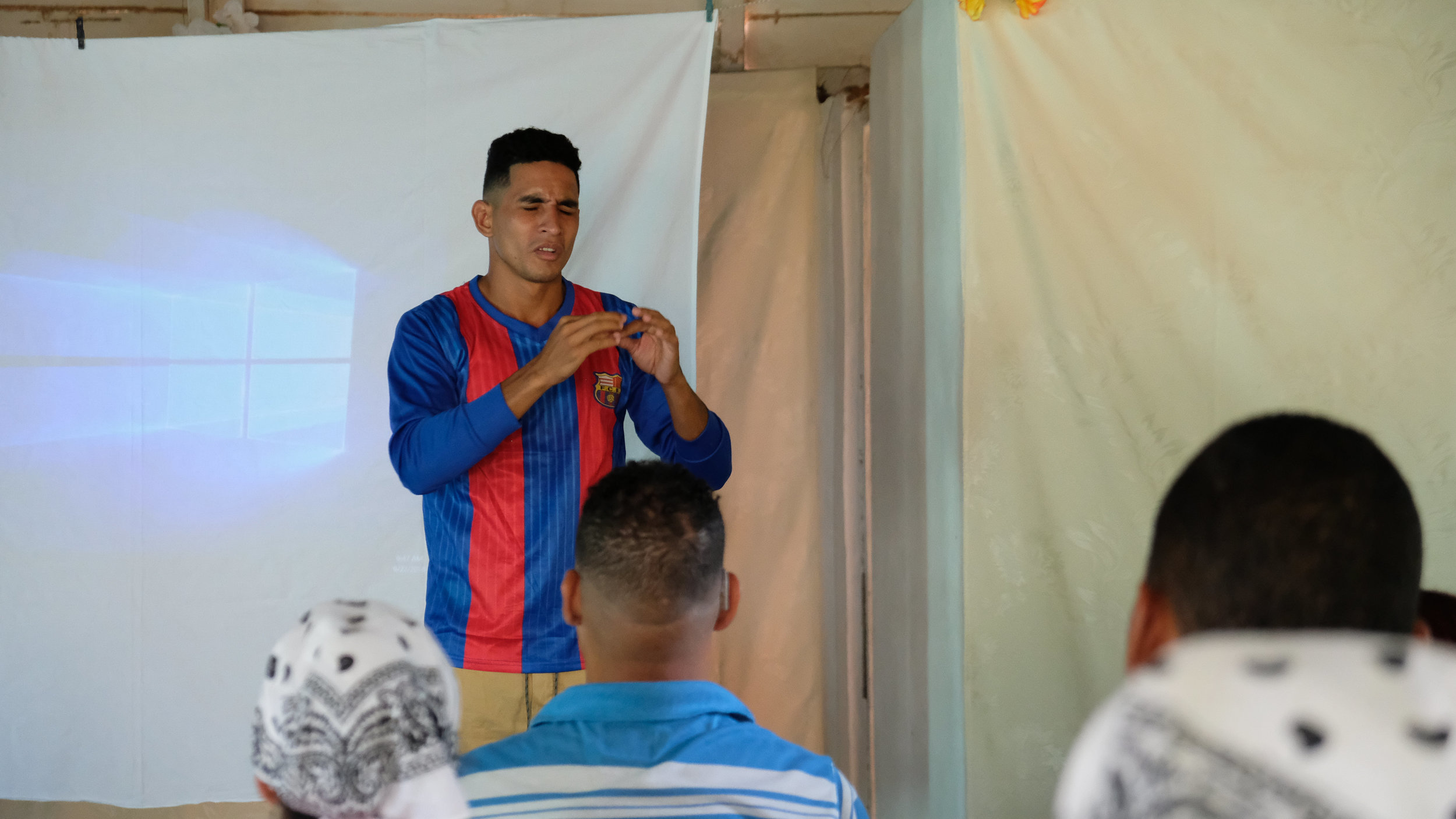 Yondris giving the closing prayer during the last devotional of the retreat