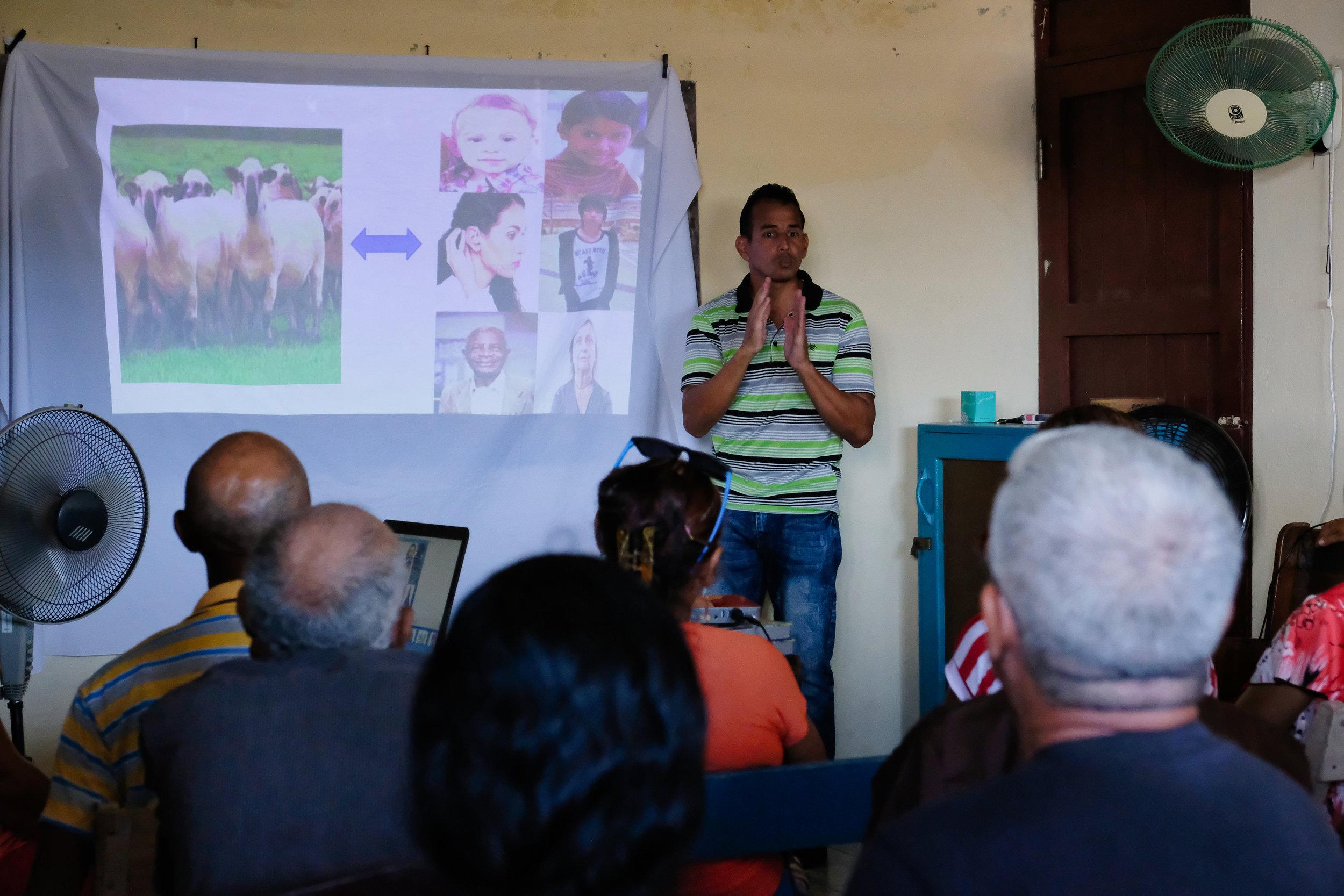 Cuban interpreter communicating Lost Sheep Story