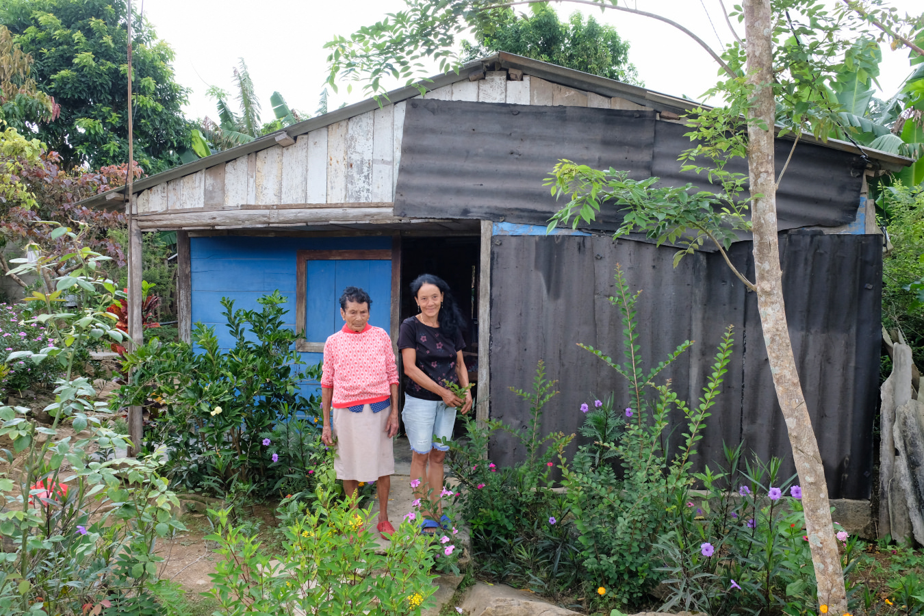 Mirian and her mother at their hurricane damaged home.