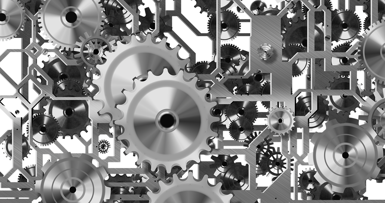 Complicated gears. The inner workings of a transparent machine.  Image by  Gerd Altmann  on Pixabay.