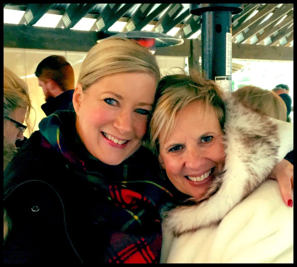 My friend Beth and I, snuggled up in plaid, faux fur, and warm coats. Man, it was  cold  that day!