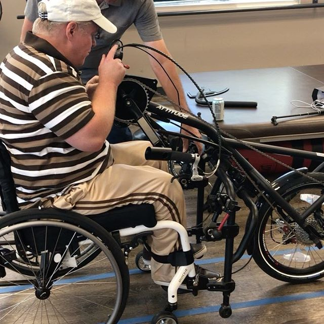 Michael trying the quickie bike that attaches directly to your wheelchair no need to transfer.  Back to biking!