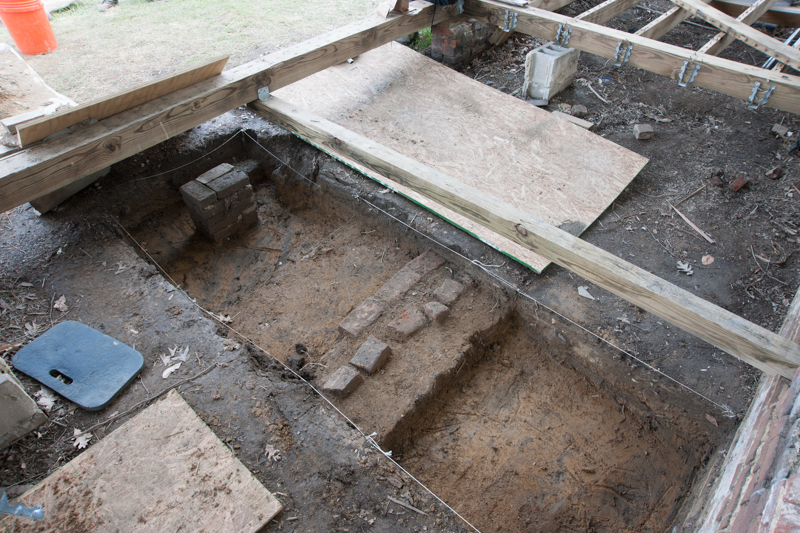 A brick foundation unearthed at the front door from a previous entrance design.