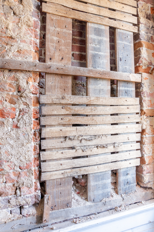 One of the window openings that was enclosed during one of the renovations to the house. These are visible in the brickwork on the front facade of the house.