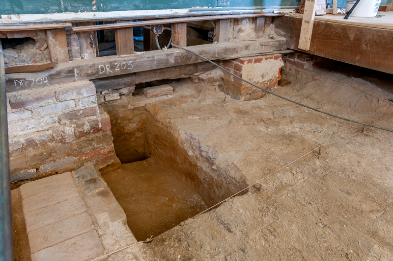 Foundations were discovered that connect the back of the stair tower to the back brick building. No date has been determined.