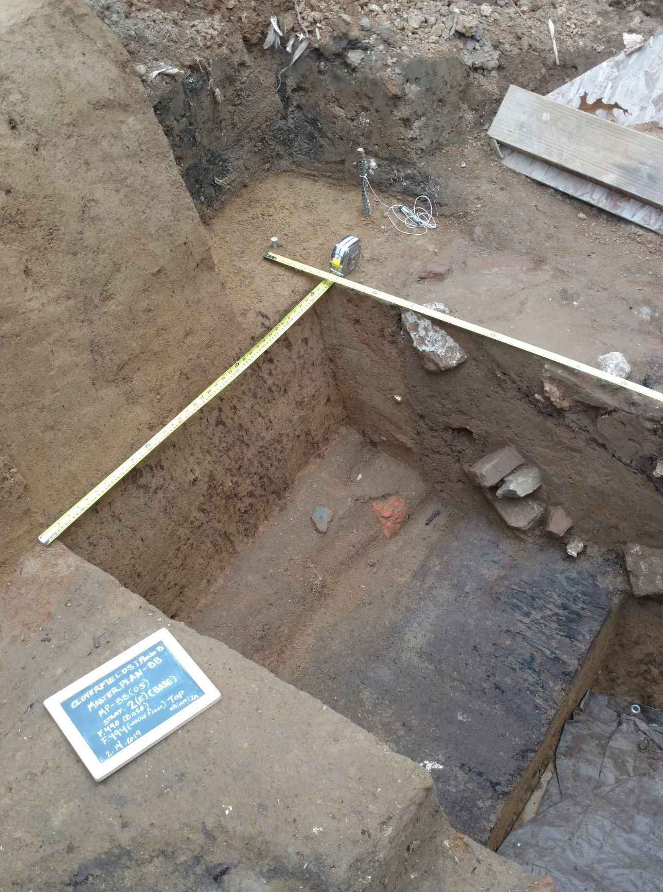 figure 1. archaeological test pit showing collapsed walls of presumed ice house. please click to enlarge.