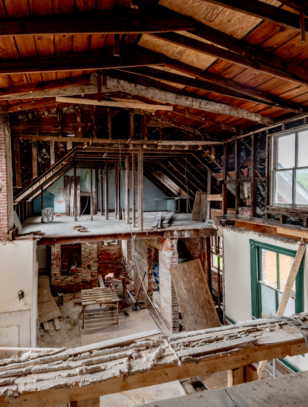 Existing 1890s two-story hyphen with the second floor removed. The photo is taken from the second floor of the stair hall of the main house. This view looks into the 1784 service building which will be reconstructed. / Photography: Pete Albert, 2019.