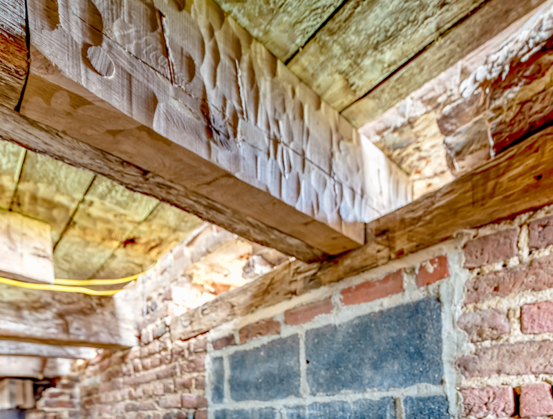 Timber scarf repair to one of the timber beams in the cellar. Notice the peg at the far left. / Pete Albert Photography
