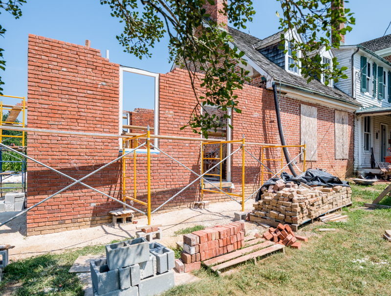 Window and door frames are installed and the masonry built around it at the 1784 kitchen. photo by Pete Albert