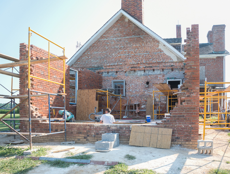 the 1784 kitchens masonry walls going up. the fireplace and beehive oven will be in the wall at the foreground. photo by Pete Albert