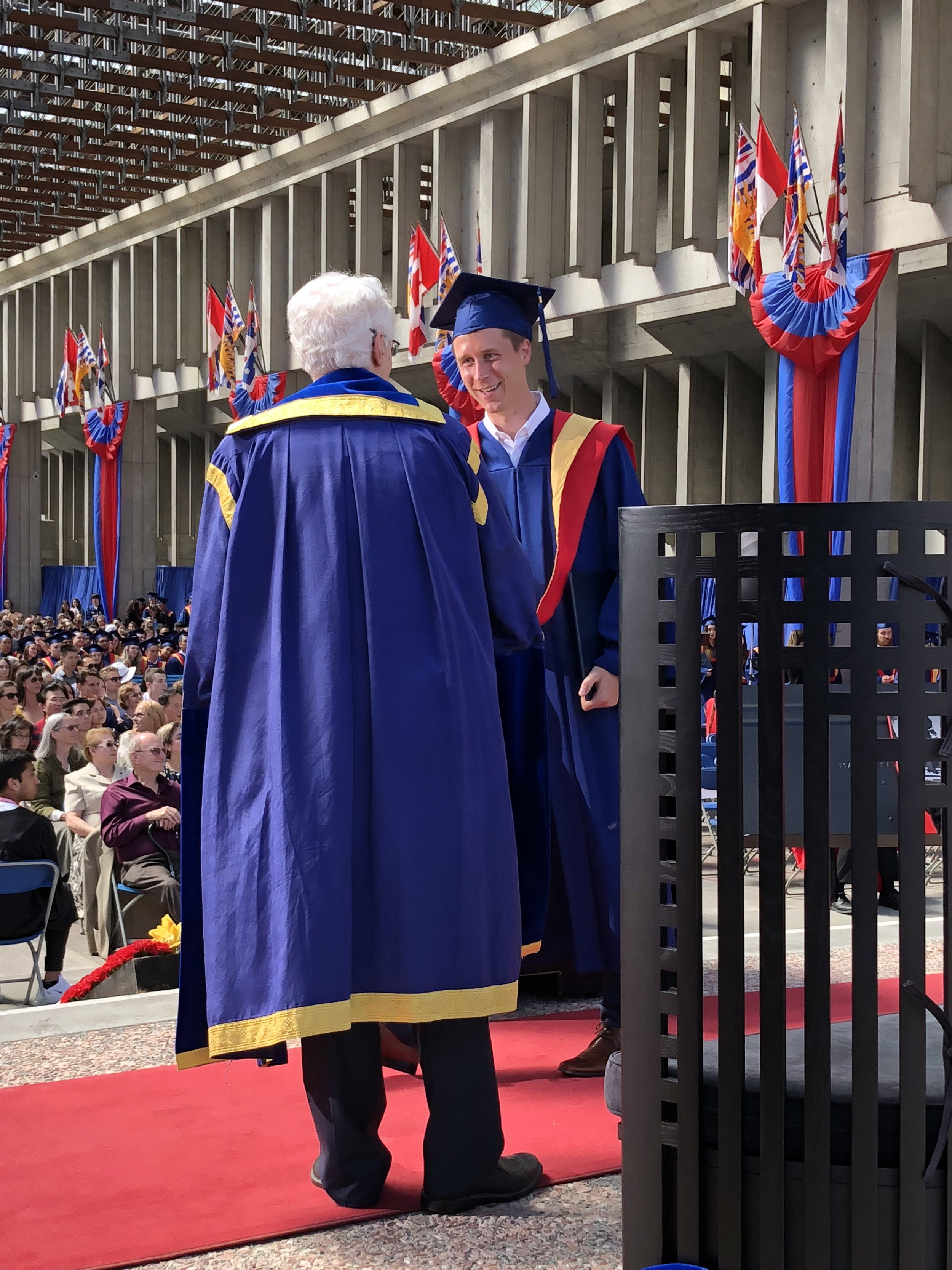 Tim shaking hands with President Petter after being awarded his M.Sc. at Convocation, June 2019