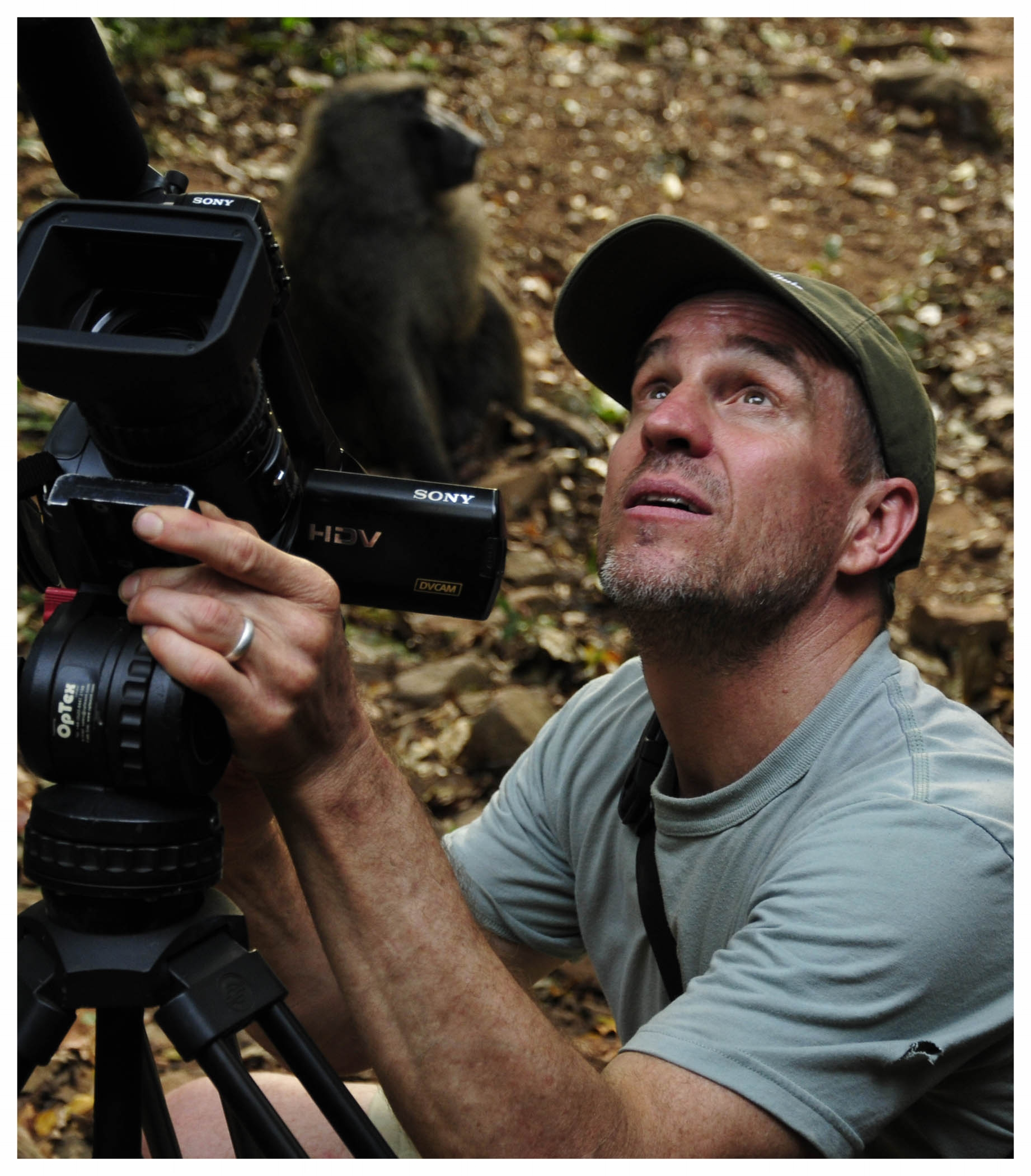 Bill Wallauer capturing video of chimpanzees. Photo credit: Jane Goodall Institute.