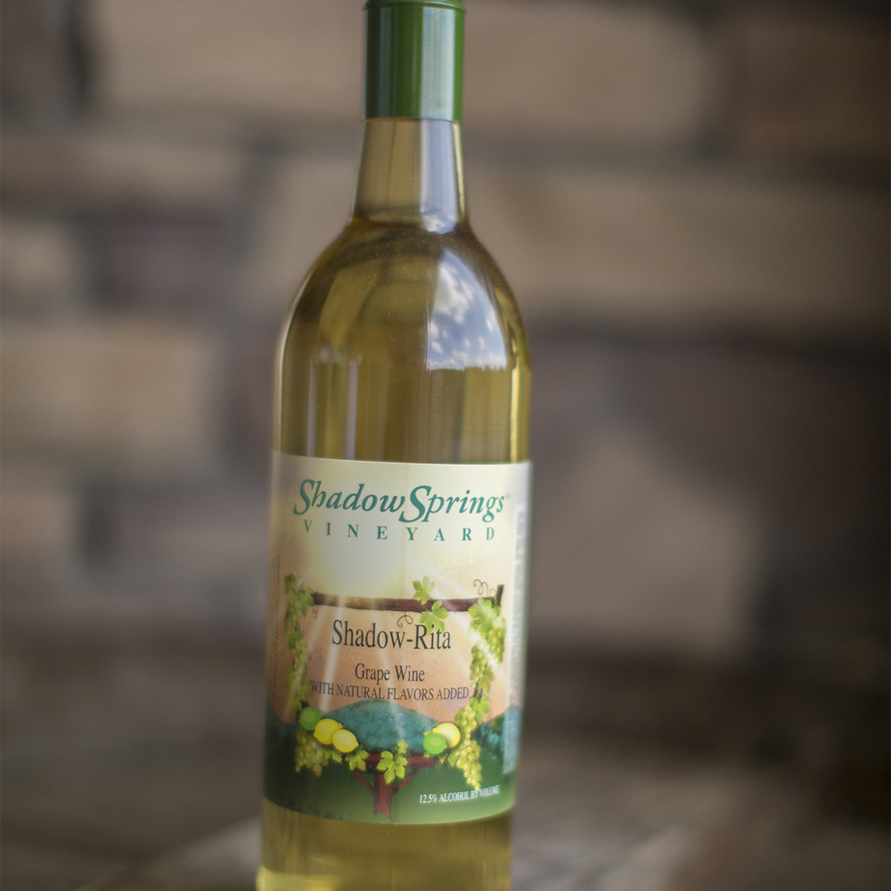 "Shadow-Rita  $17  This is a white wine blend with the addition of citrus juice, sweetness, and brandy. This ""margarita"" style wine is perfect for blending with ice"