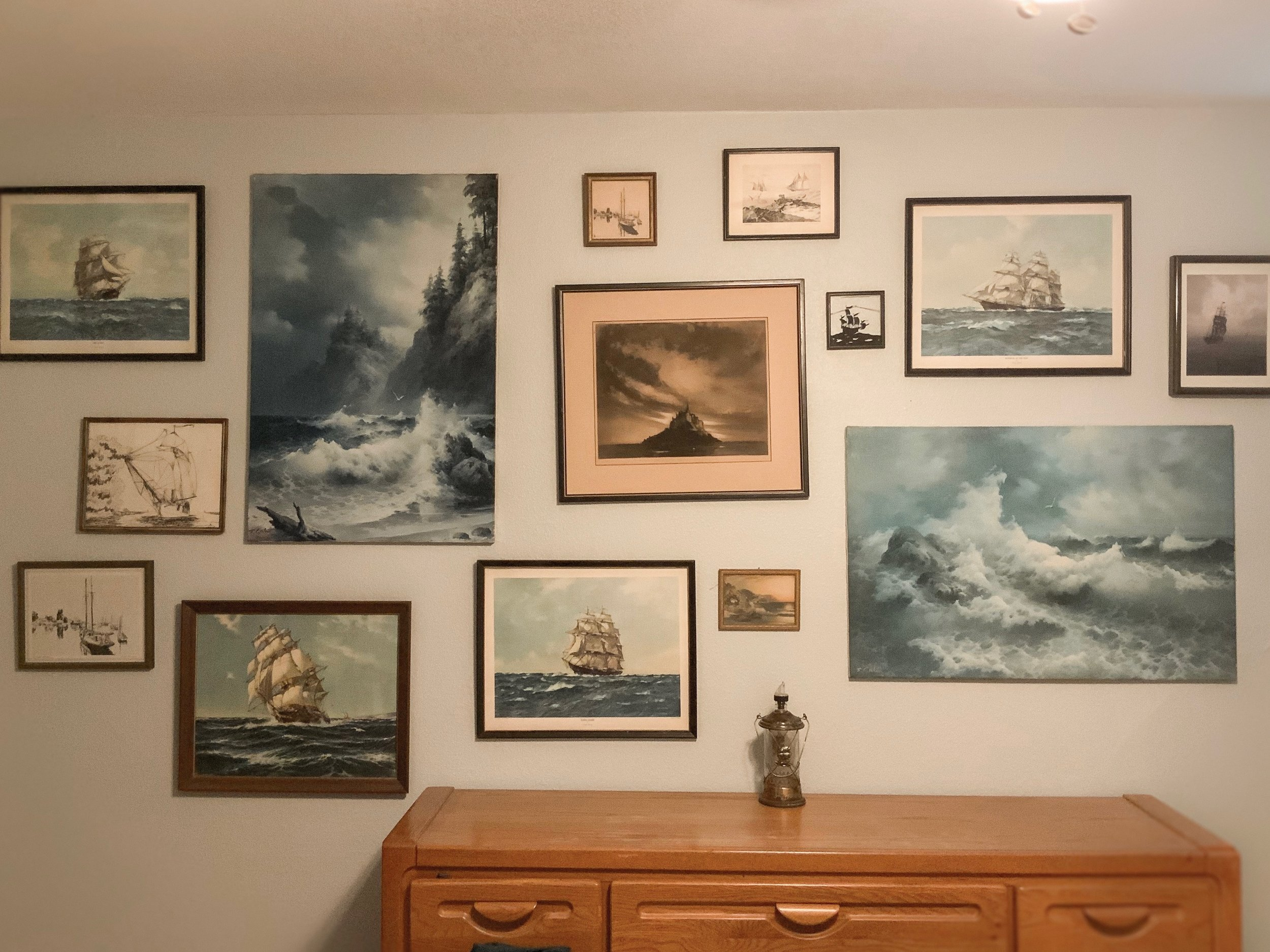 The famous ship wall! So that middle darker piece was the one I started with, then the two big one on either side of that. And I like the different amounts of space between each piece. I feel that it makes the wall more genuine and real.