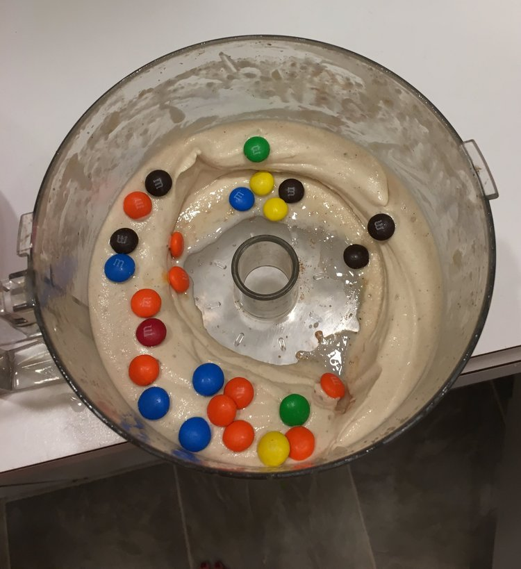 """My most recent """"smoothie"""". I'm pretty sure this is not what the health blogs were talking about. You want the recipe? Ok! Frozen banana, cinnamon, a dash of almond milk (for health), cocoa powder. Blend in food processor. Add M and M's. Sprinkles or chocolate syrup would also work."""