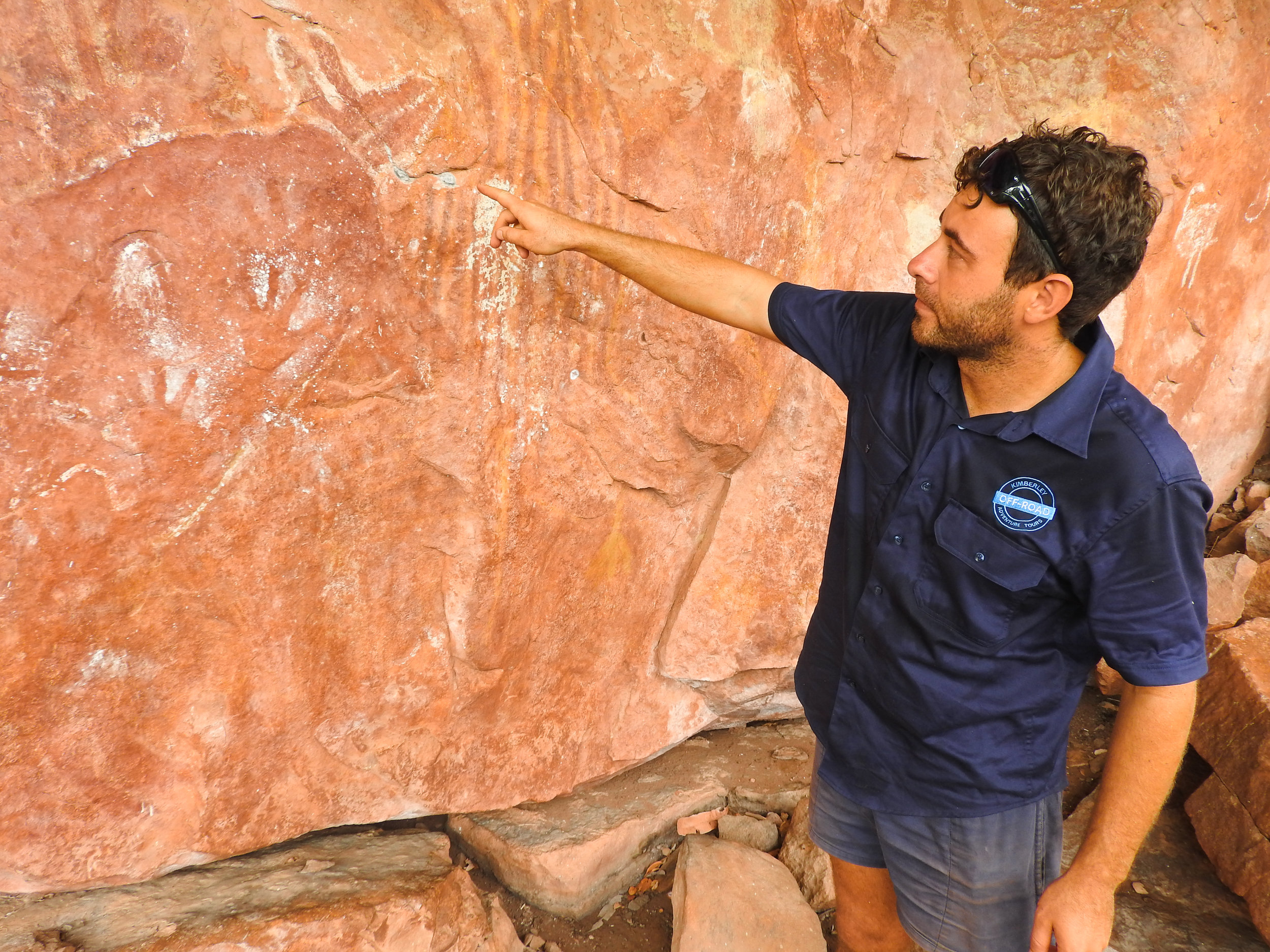 Guide Adam tells his passengers about the history of the local rock art