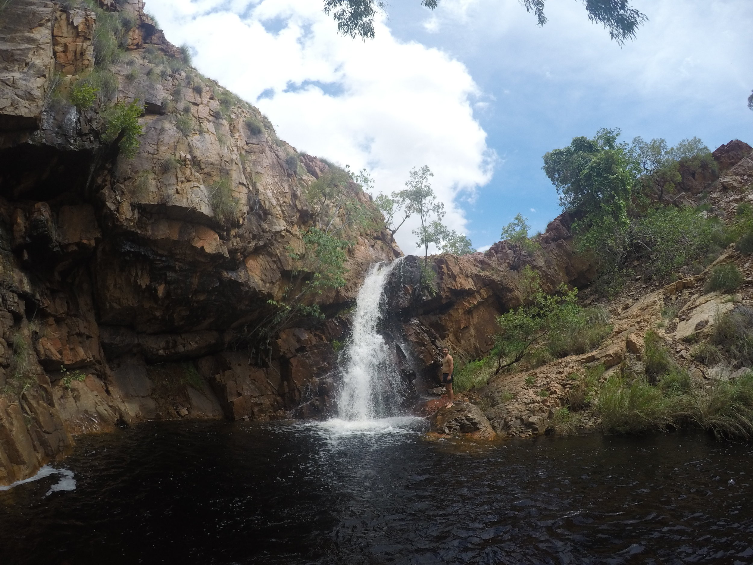 Adam checking out a Kimberley waterfall in the wet season
