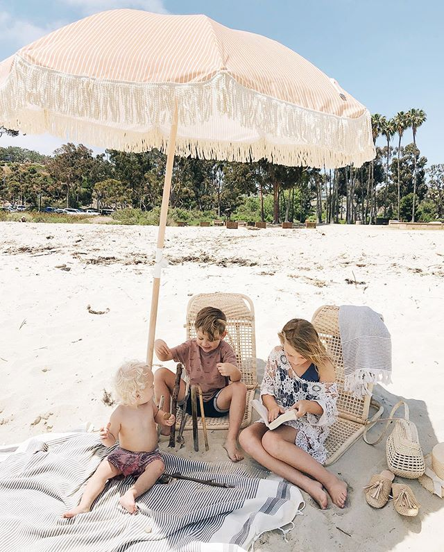 today i rocked my sleeping baby for two hours on beach while my daughter surfed with her dad and my son played with sticks in his own little world. these are the days! ✨ use code amber10  for a discount on these beach chairs at @stowedhome