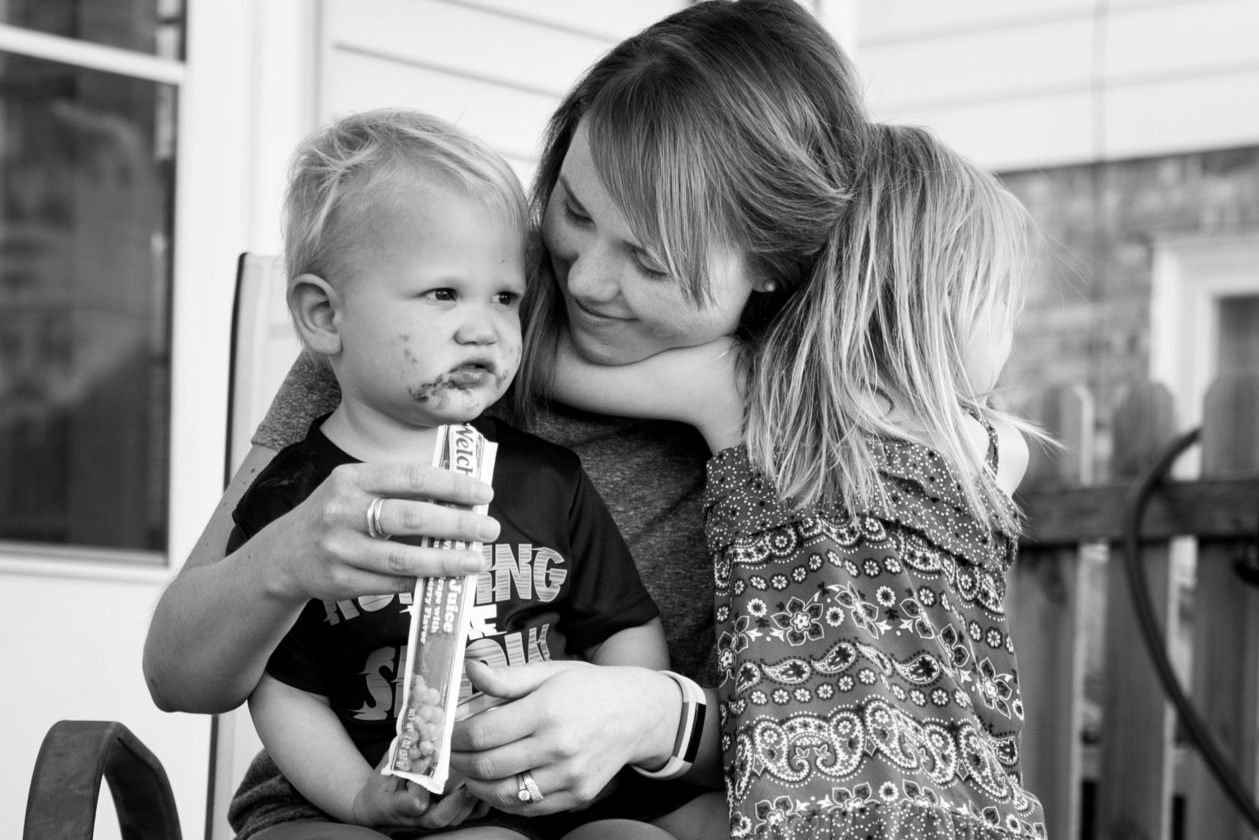 Kari Gierach Photography, Milwaukee Wisconsin documentary family photographer, Wauwatosa candid family photo, mom and kids hugging-1.jpg