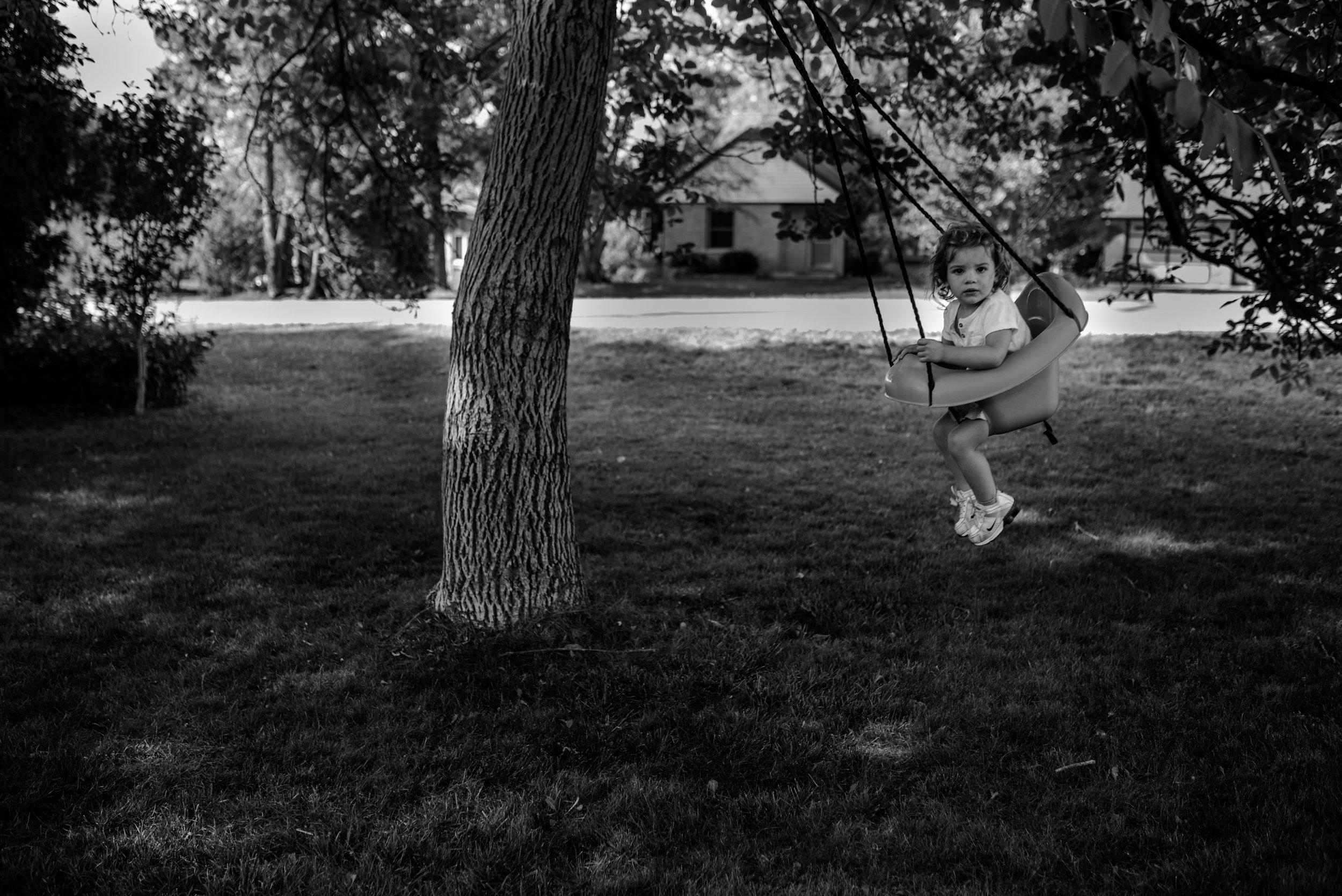 girl in swing outside
