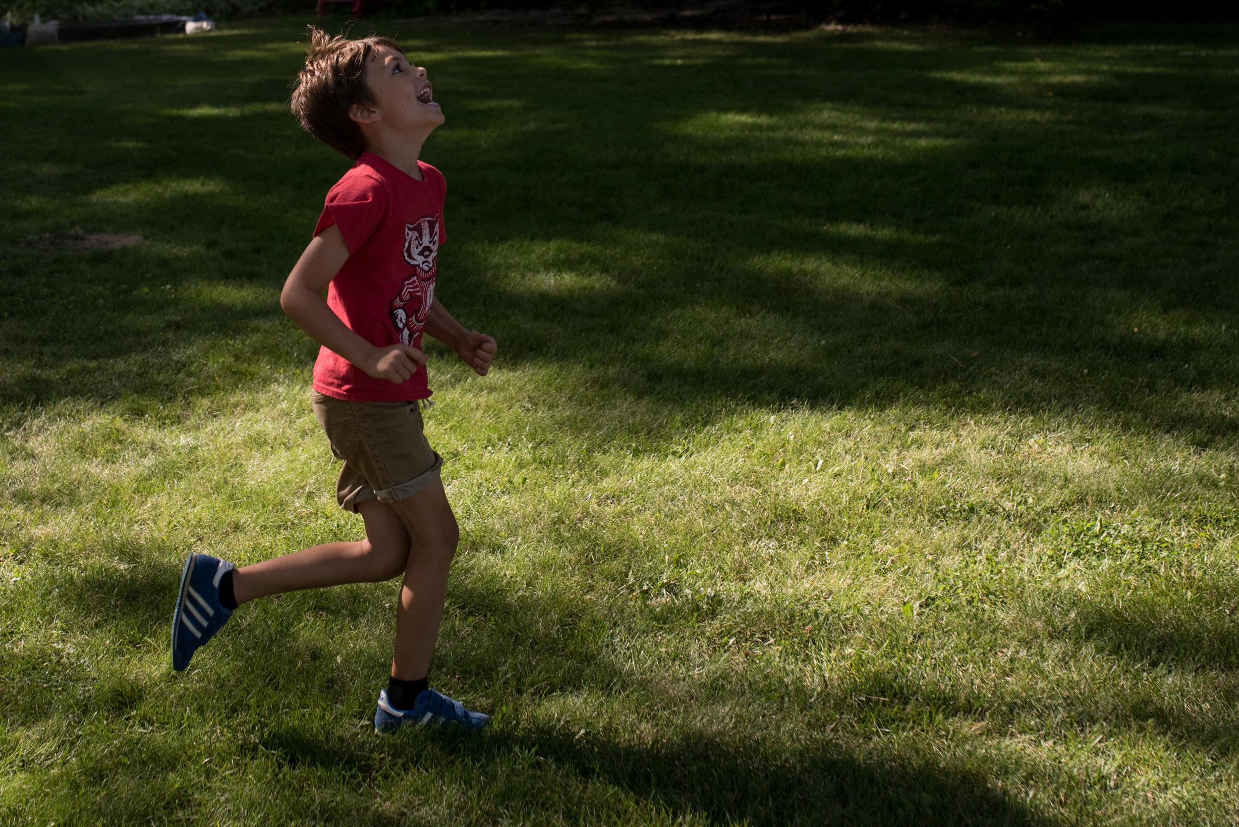 boy running in yard