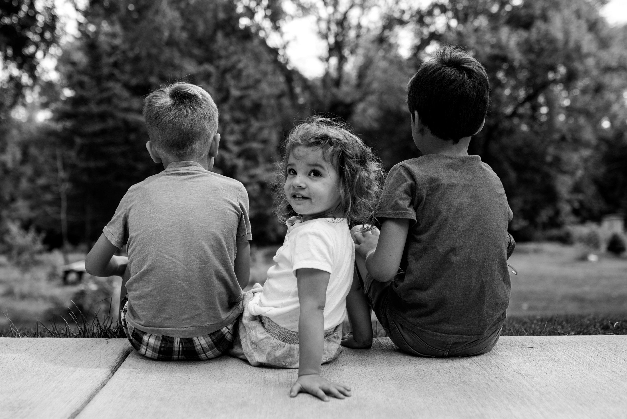 siblings sitting outside