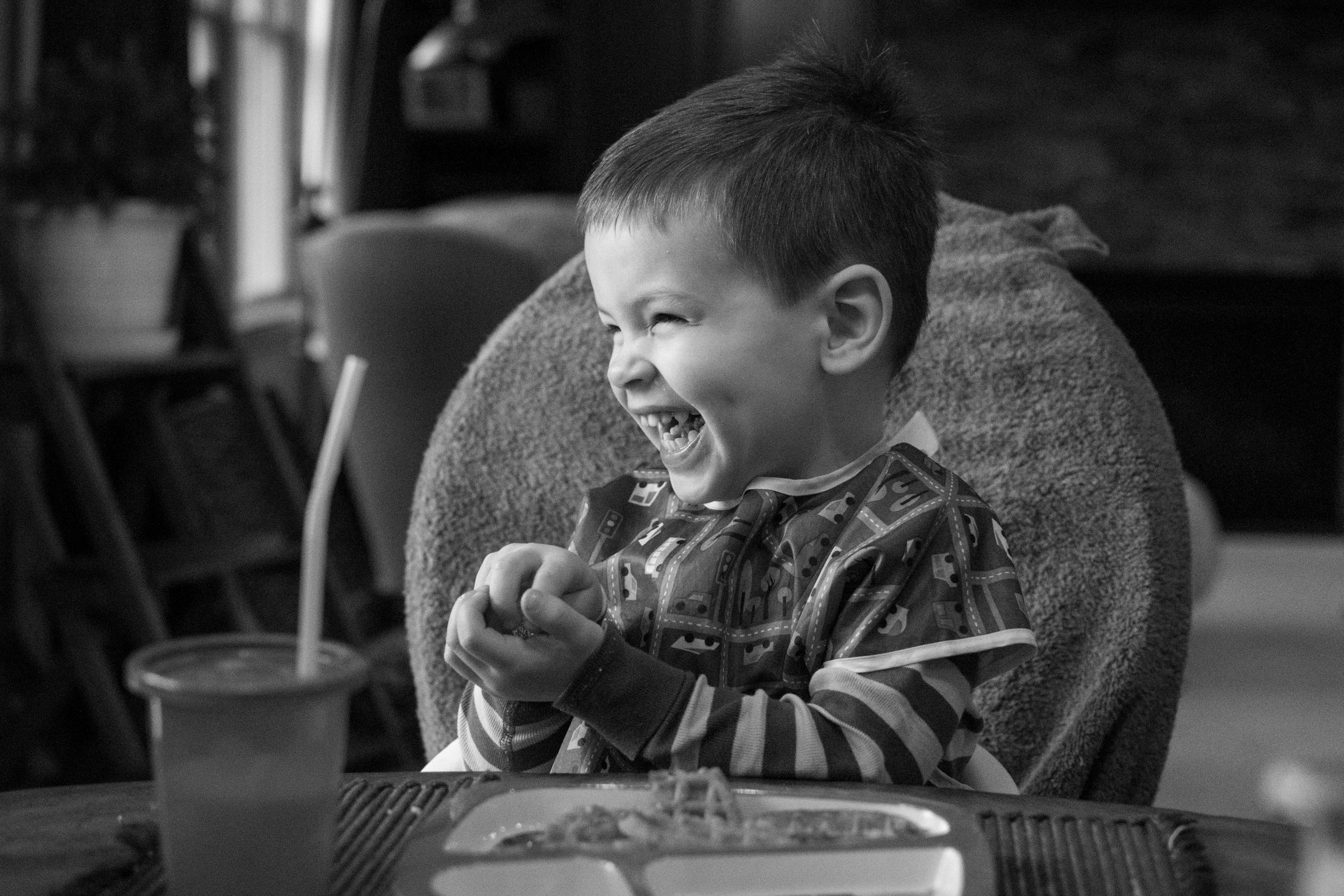Boy laughing in kitchen