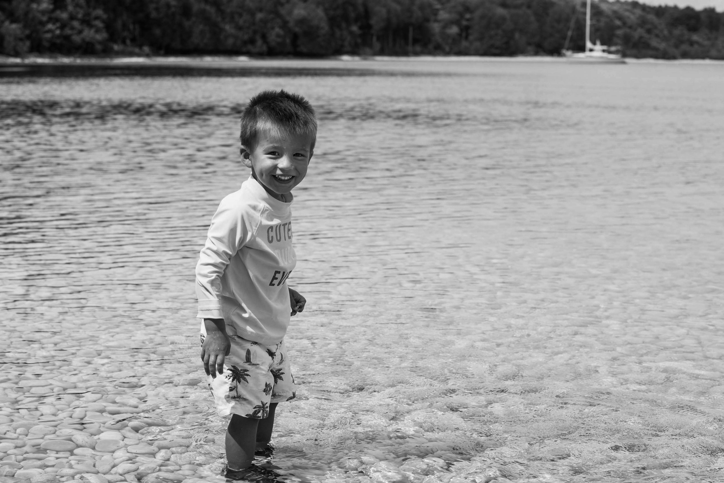 boy smiling in the water