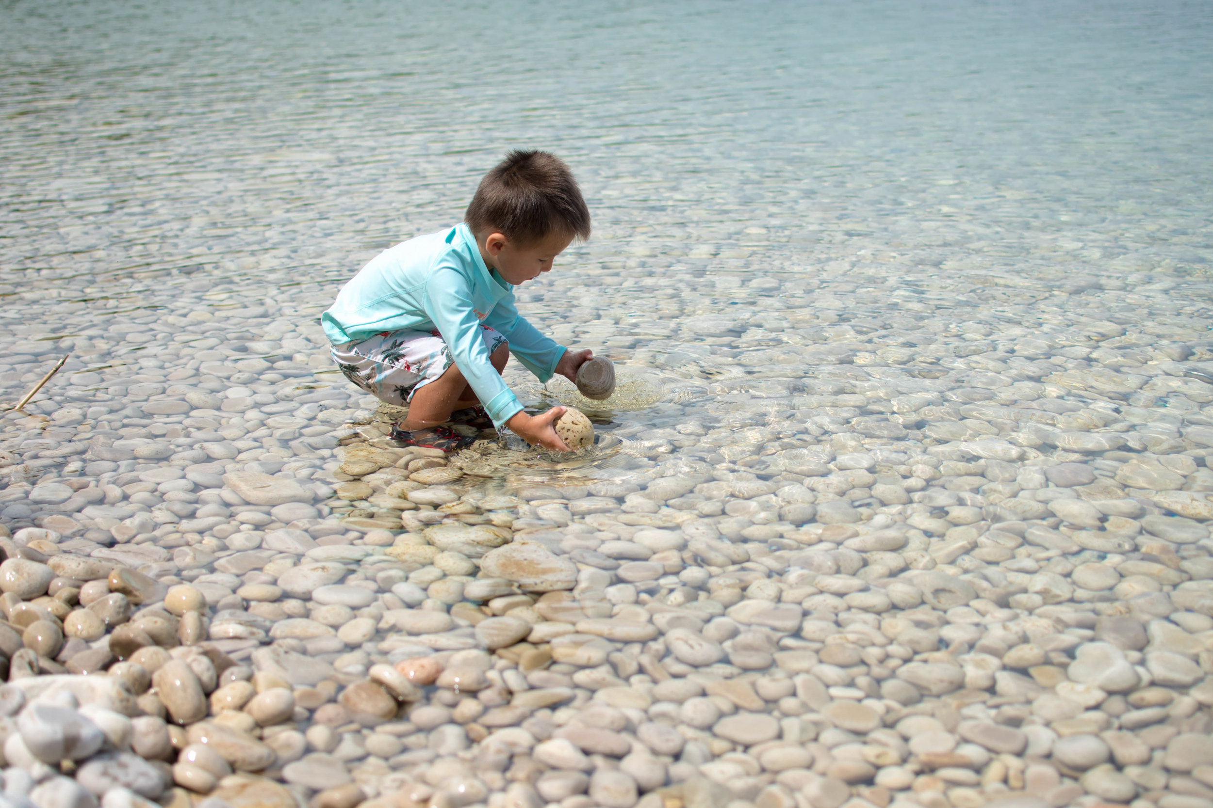 Boy playing in the water at schoolhouse beach