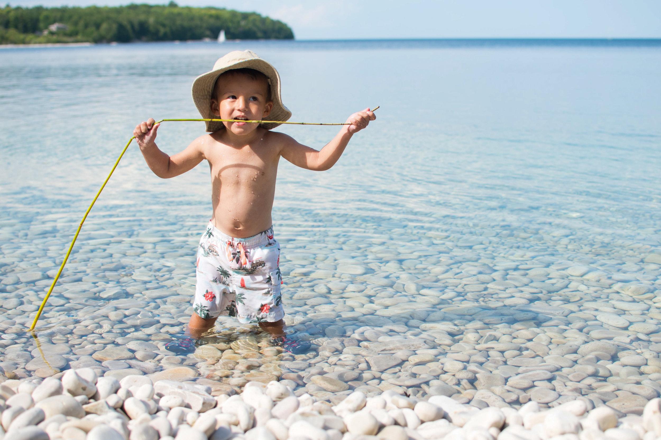 Boy eating seaweed on beach