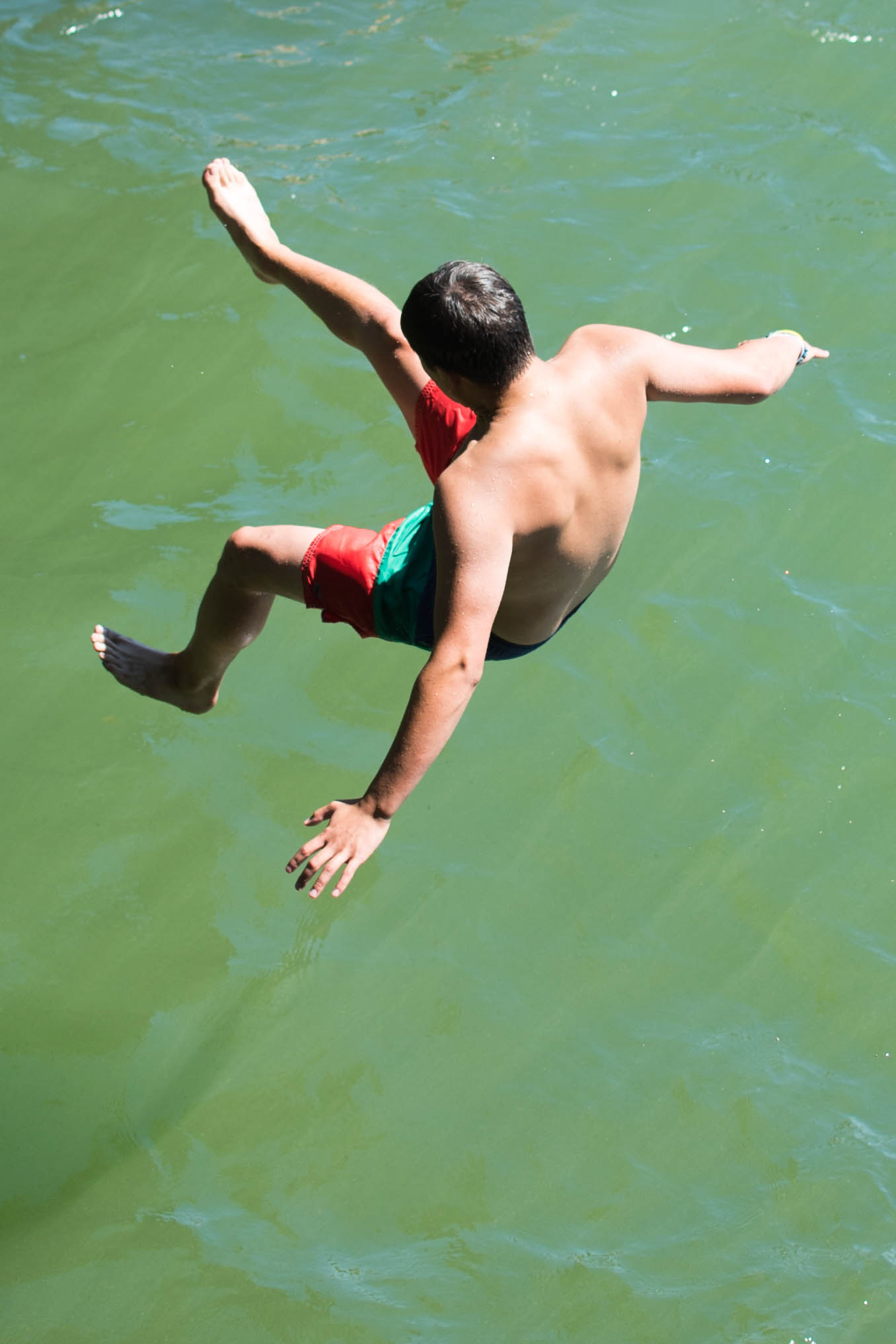 Man jumping in the water, jumping off cliff
