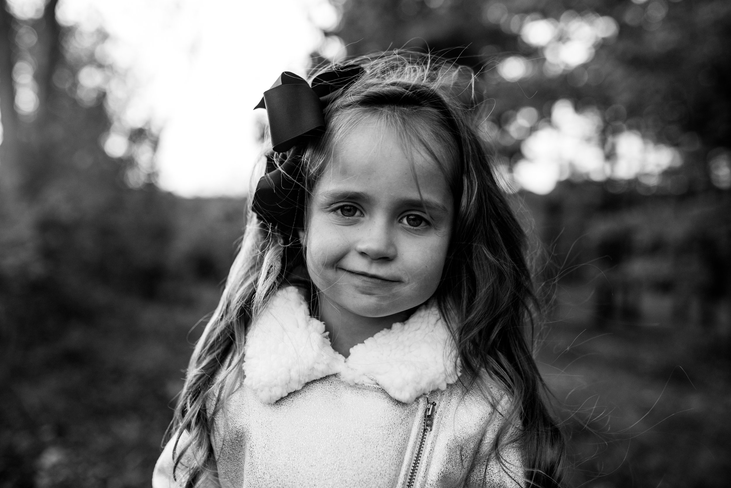 Young girl looking at the camera with a smirk