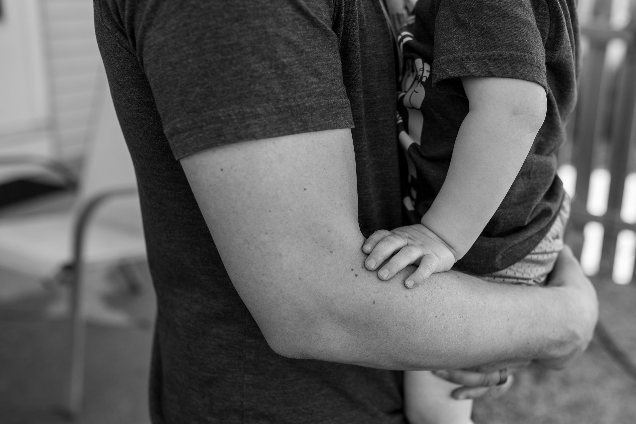 Dads arms holding son