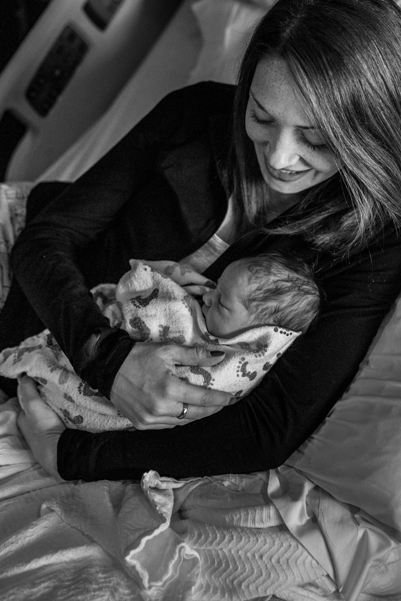 Mom holding newborn baby in Childrens Hospital of Wisconsin hospital bed
