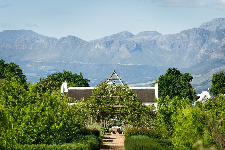 Farmhouse with mountains as backdrop