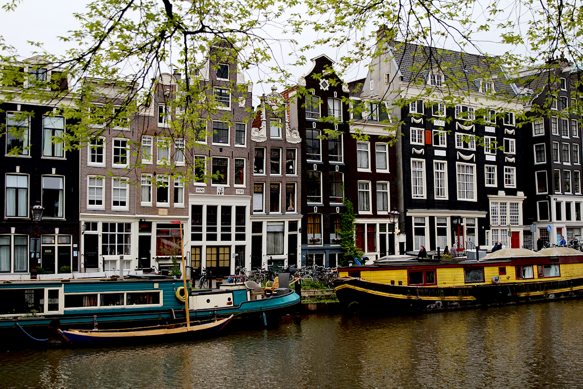 Traditional Dutch buildings by a canal in Amsterdam