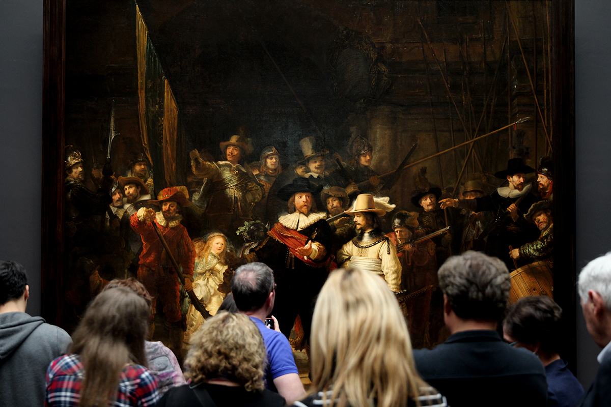 People staring at a painting in Rijksmuseum, Amsterdam