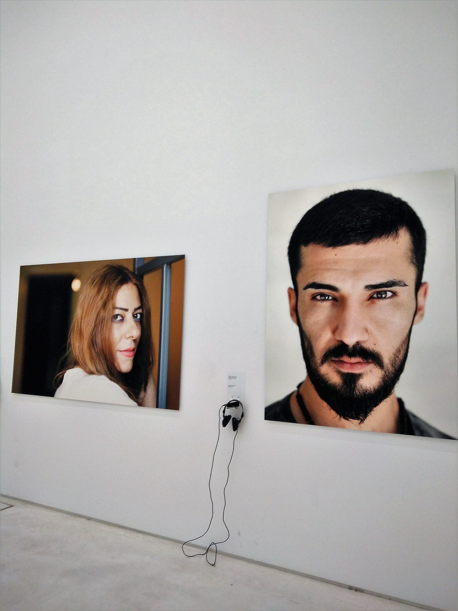 """Different stories from different people who were forced to leave their homes at the """"Face Forward"""" exhibition."""