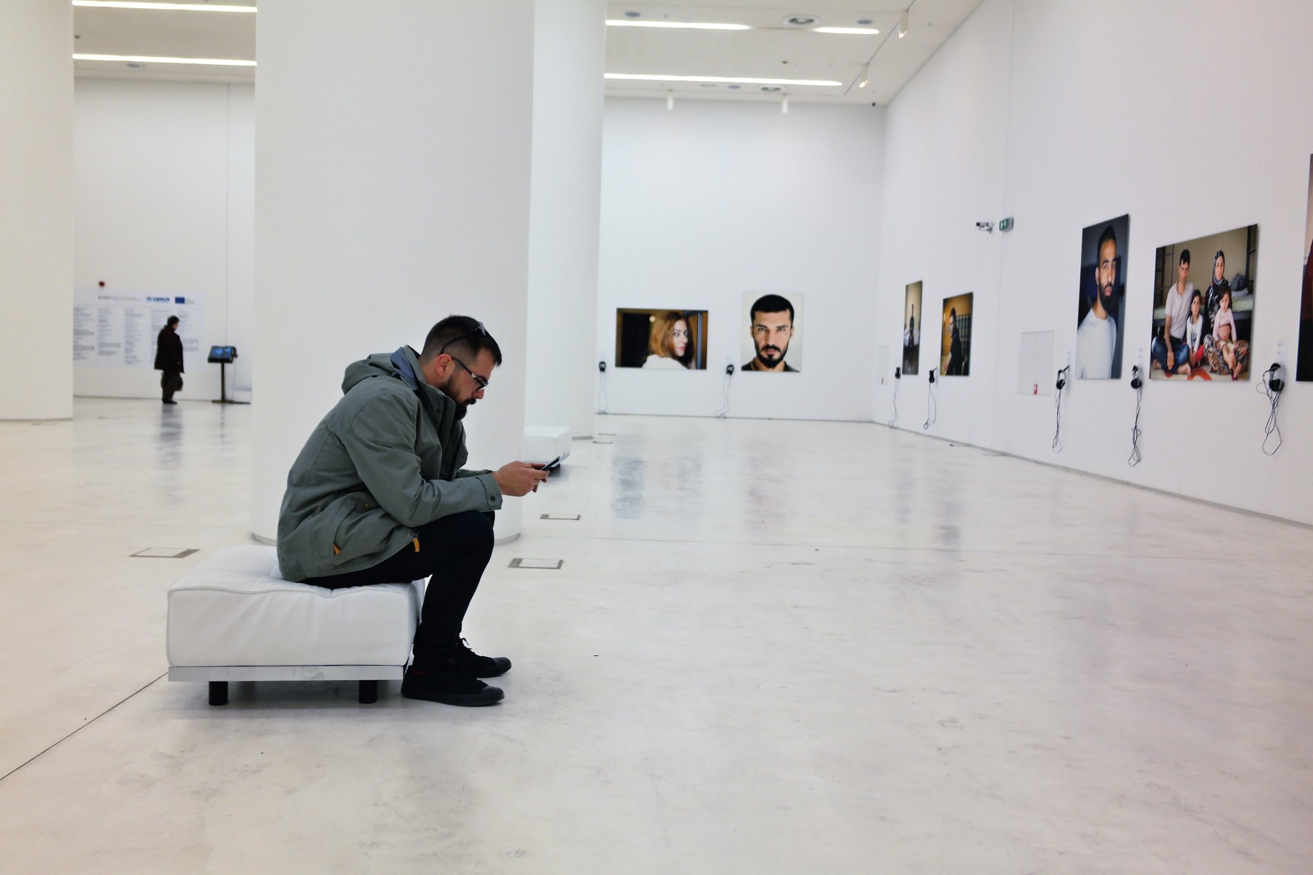 All refugee portraits are presented in a clean wide space at the ground floor of the National Museum of Contemporary Art in Athens.