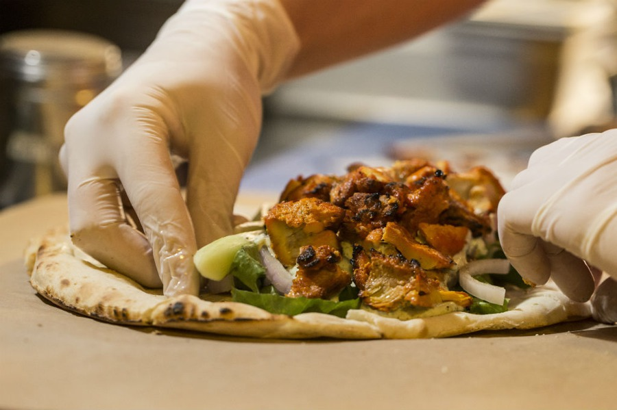 While preparing the so-called Indian souvlaki in Athens, Greece. Source:  GreekGuide