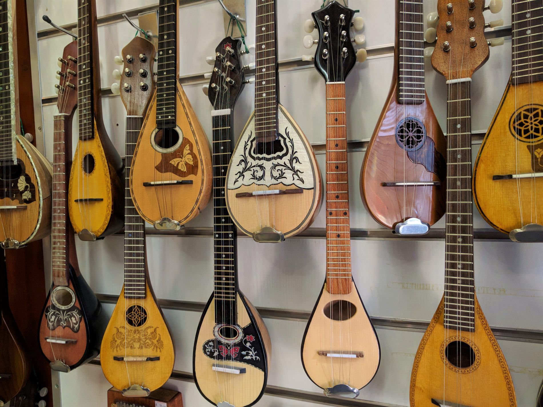 "All different types of "" bouzouki "" as found in Pandrossou str. in Monastiraki. Source: Truevoyagers"